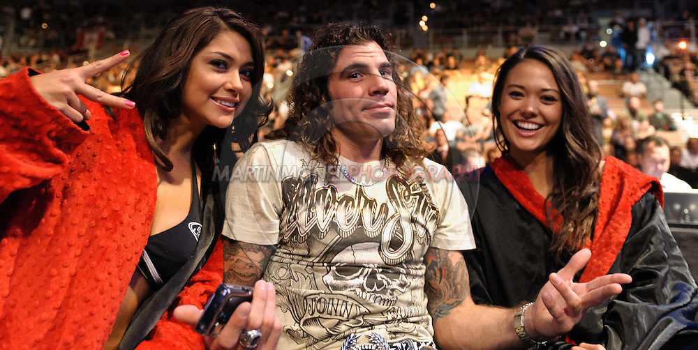 "LAS VEGAS, NEVADA. JULY 11, 2009: Lightweight division fighter Clay Guida (center) poses with ring girls Arianny Celestse (left) and Logan Stanton (right) during ""UFC 100: Making History"" inside the Mandalay Bay Events Center in Las Vegas, Nevada."