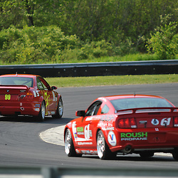 May 23, 2009; Lakeville, CT, USA; The Automatic Racing BMW M3 Coupe leads the Horsepower Ranch Ford Mustang GT into Big Bend in practice for the Grand-Am Koni Sports Car Challenge series competition during the Memorial Day Road Racing Classic weekend at Lime Rock Park.