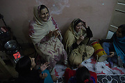 11 December 2013. Sialkot, Pakistan. Women celebrate her cousin's wedding who will be moving to the US after her wedding. Photo by Sehar Mughal/NYCity Photo Wire