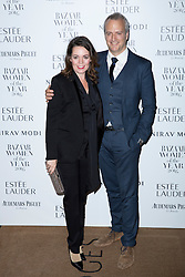 Olivia Colman and her husband attending the Harper's Bazaar Woman of the Year awards at Claridges in London. Picture date: Monday October 31, 2016. Photo credit should read: Isabel Infantes / EMPICS Entertainment.