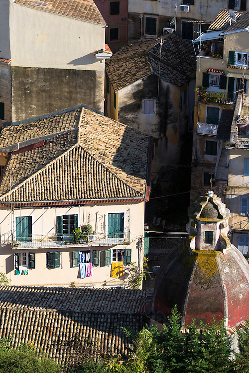 Church dome, homes with washing lines among rooftops in Kerkyra, Corfu Town, Greece