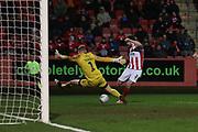 David Cornell blocks a Sean Long shot   during the EFL Sky Bet League 2 match between Cheltenham Town and Northampton Town at Jonny Rocks Stadium, Cheltenham, England on 25 February 2020.