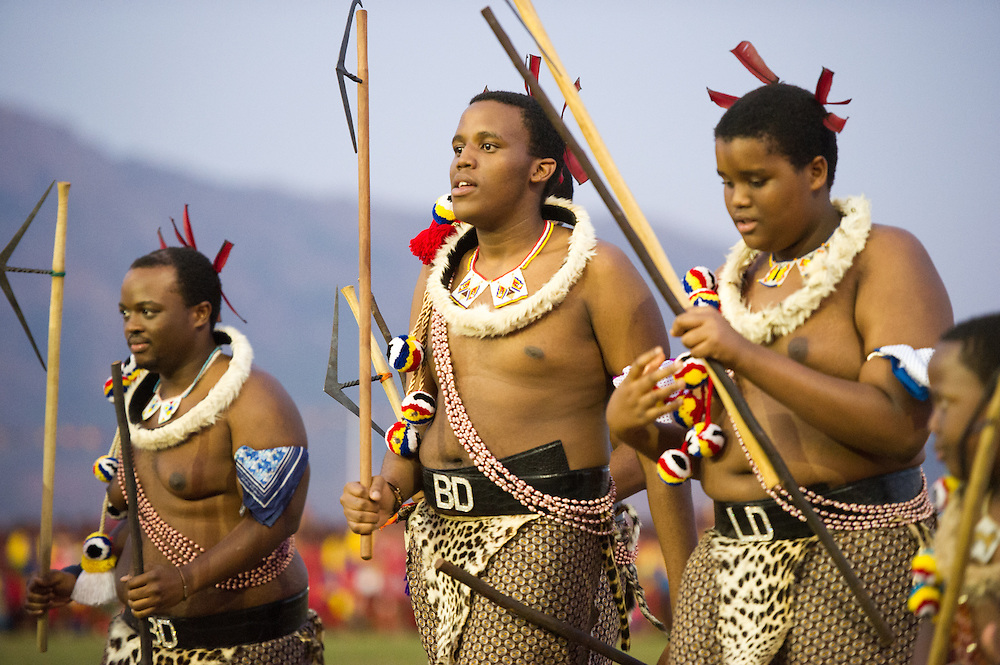 Ludzidzini, Swaziland, Africa - Annual Umhlanga, or reed dance ceremony, in which up to 100,000 young Swazi women gather to celebrate their virginity and honor the queen mother during the 8 day long event.<br /> Princes leaving the dancing field