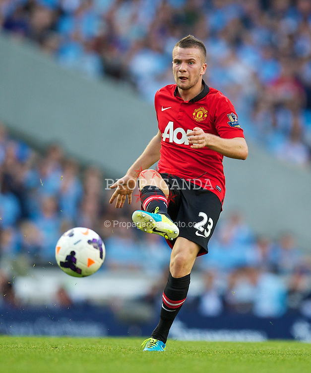 MANCHESTER, ENGLAND - Sunday, September 22, 2013: Manchester United's Tom Cleverley in action against Manchester City during the Premiership match at the City of Manchester Stadium. (Pic by David Rawcliffe/Propaganda)