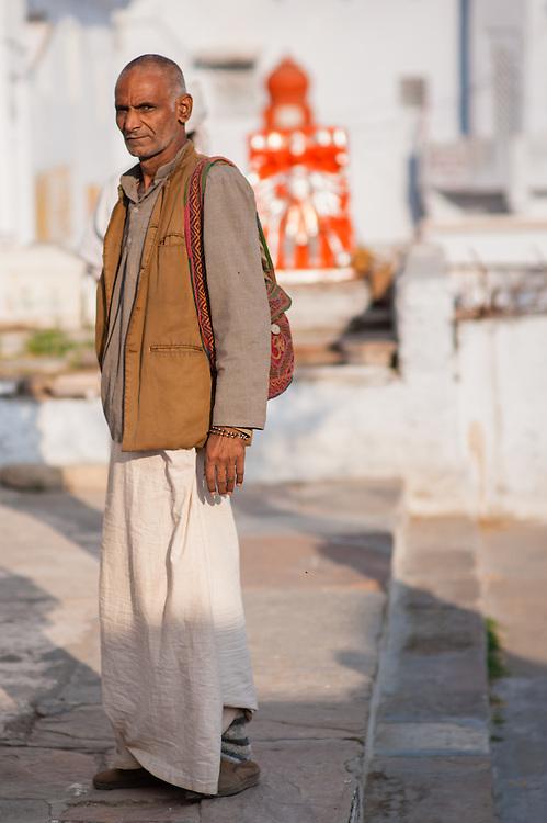Man standing by Pushkar lake (India)