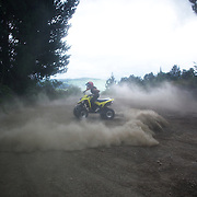 A quad biker performs a donut on a quad bike course near Taupo with Taupo Quad Bikes. Taupo, New Zealand. 7th January 2011. Photo Tim Clayton..