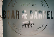 Front glass door signage for Boar and Barrel in Madison, WI on Thursday, May 16, 2019.