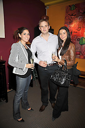 Letf to right, LILY HODGES and MICHAEL & NATALIE BURGESS at a party to celebrate the publication of Joth Shakerley's book 'Pregnant Women' held at 598a Kings Road, London SW6 on 20th May 2009.