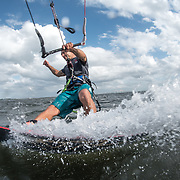 Pro rider Billy Parker is gliding over the water in the Gulf of Mexico, Florida.