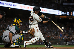 SAN FRANCISCO, CA - AUGUST 13: Buster Posey #28 of the San Francisco Giants hits a double against the Oakland Athletics during the sixth inning at Oracle Park on August 13, 2019 in San Francisco, California. The San Francisco Giants defeated the Oakland Athletics 3-2. (Photo by Jason O. Watson/Getty Images) *** Local Caption *** Buster Posey