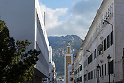 TETOUAN, MOROCCO - 6th April 2016 - Mosque and building architecture with mountain backdrop in the Tetouan Medina, Rif region of Northern Morocco.