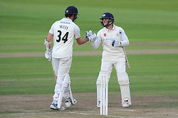 Craig Miles of Gloucestershire congratulates Chris Dent of Gloucestershire as he scores 200 runs surpassing his previous record of 153 runs - Mandatory byline: Dougie Allward/JMP - 07966386802 - 24/09/2015 - Cricket - County Ground -Bristol,England - Gloucestershire CCC v Glamorgan CCC - LV=County Championship - Division Two - Day Three