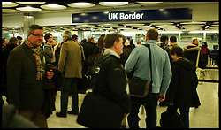 Travellers at Heathrow Terminal 5 queue to have their passports checked at the UK Border. Flights have been delayed over the weekend due to snow, Monday February 6, 2012. Photo By Andrew Parsons/ i-Image..