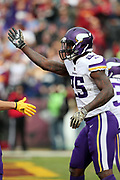 Minnesota Vikings running back Latavius Murray (25) celebrates after running for a first quarter touchdown that ties the score at 7-7- during the 2017 NFL week 10 regular season football game against the Washington Redskins, Sunday, Nov. 12, 2017 in Landover, Md. The Vikings won the game 38-30. (©Paul Anthony Spinelli)