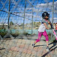 Viviana Aleman takes a swing during the batting practice with Pirates on the first day of Gallup Amateur Baseball Softball Association 12 and under practice at the Gallup Sports Complex Tuesday.