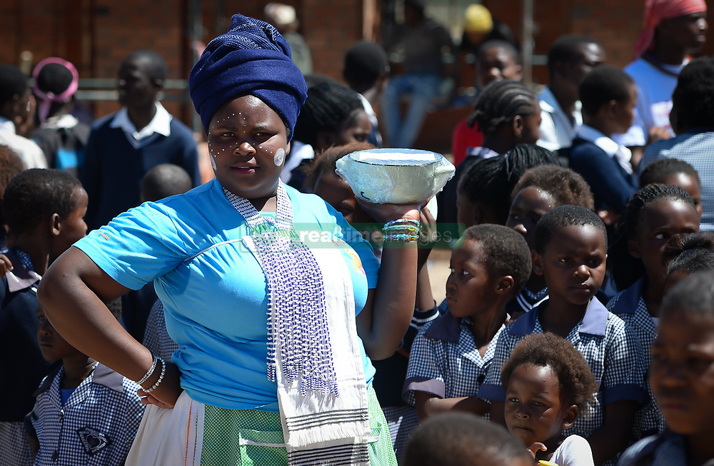 Nov. 21, 2014 - Mthatha, Eastern Cape, South Africa - A young lady from Mandela's homeland of Mthatha surranded by school children. Mthatha, Eastern Cape, South Africa. (Picture by: Artur Widak/NurPhoto) (Credit Image: © Artur Widak/NurPhoto/ZUMA Wire)