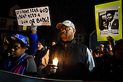 Troy Robinson stands in the crowd during a candlelight vigil on Williamson Street on Sunday night for Tony Robinson, March 8, 2015. Robinson was an unarmed black teen shot on Friday by Madison Police inside his home. REUTERS/Ben Brewer (UNITED STATES)