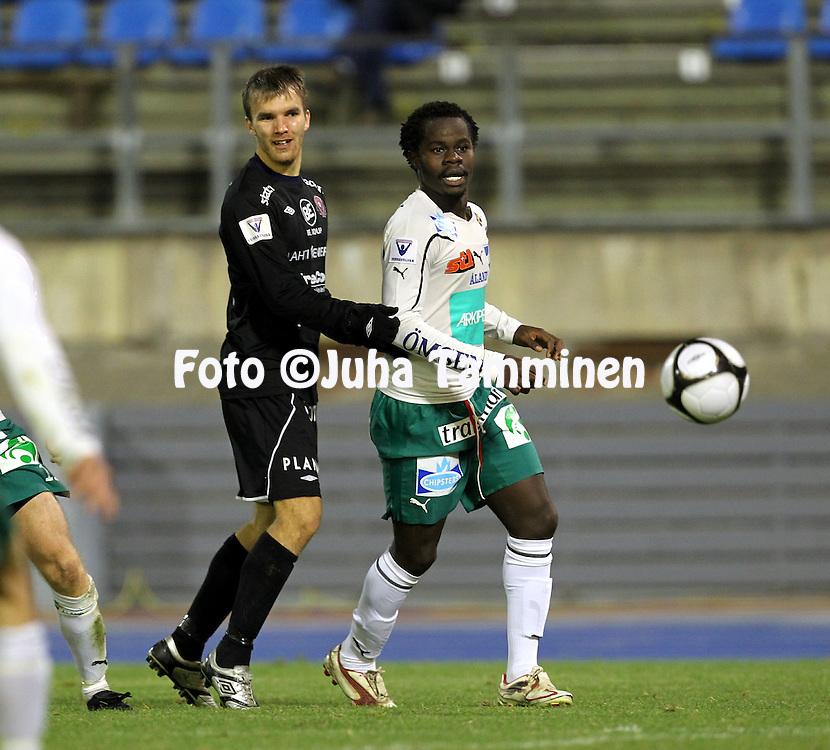 17.10.2010, Stadion, Lahti..Veikkausliiga 2010, FC Lahti - IFK Mariehamn..Jarkko V?rtt? (FC Lahti) v Amos Ekhalie (IFK Mhamn)..©Juha Tamminen.