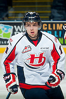 KELOWNA, CANADA - OCTOBER 11: Taylor Cooper #11 of Lethbridge Hurricanes warms up against the Kelowna Rockets on October 11, 2014 at Prospera Place in Kelowna, British Columbia, Canada.   (Photo by Marissa Baecker/Shoot the Breeze)  *** Local Caption *** Taylor Cooper;