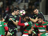 Sporting's player Paulo Oliveira (L ) fights for the ball with Maritimo´s player Raul Silva   (C ) during Portuguese First League football match Maritimo vs Sporting held at Barreiros Stadium, Funchal, Portugal, 21 January, 2017.  EPA / GREGÓRIO CUNHA