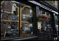 June 7, 2017 - London, London, United Kingdom - Image licensed to i-Images Picture Agency. 07/06/2017. London, United Kingdom. The Bunch of Grapes pub across the road from Borough Market in London, still closed, with black plastic in the windows following the  London Bridge terror attack. Picture by Stephen Lock / i-Images (Credit Image: © Stephen Lock/i-Images via ZUMA Press)