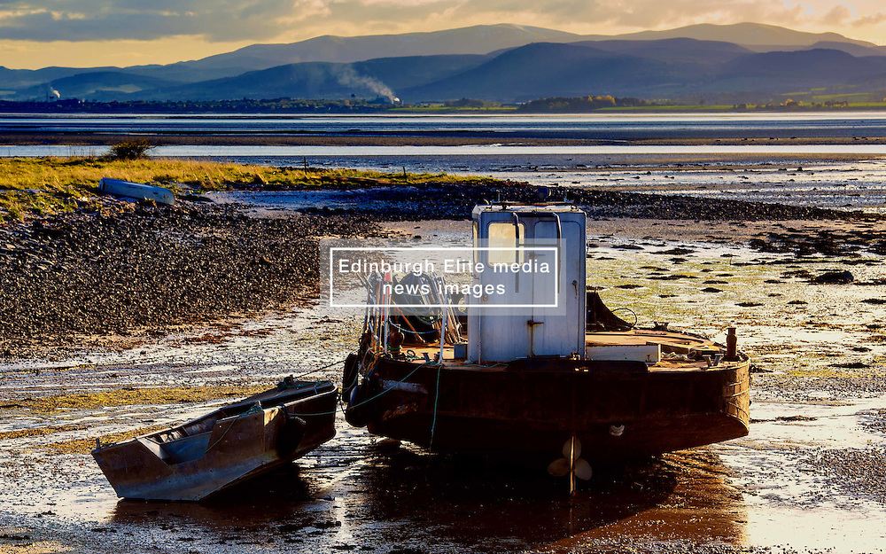 A barge sits in the Cromarty Firth Scotland grounded by a low tide bathed in light from the setting sun<br /> <br /> (c) Andrew Wilson   Edinburgh Elite media