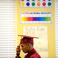 052513  Adron Gardner/Independent<br /> <br /> Rehoboth Lynx Cody Tom adjusts his graduation cap before making the walk for his diploma in Rehoboth Saturday.