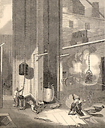 Pit head scene at South Hetton Colliery, County Durham, England:  a) Banksman unhooking corves, b) Hammer for signalling to bottom of the shaft, c) Miners descending the shaft in a corve, d) Banksman and boy shooting coal through screening holes  Engraving from 'The Penny Magazine' (London, March 1835).