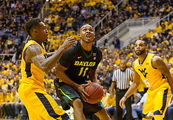 Feb 6, 2016; Morgantown, WV, USA; Baylor Bears guard Lester Medford (11) shoots under the basket during the first half against the West Virginia Mountaineers at the WVU Coliseum. Mandatory Credit: Ben Queen-USA TODAY Sports