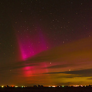 Green, orange, purple and red Aurora Borealis fill the sky in southwest Idaho