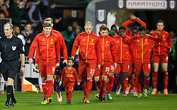 LONDON, ENGLAND - Wednesday, February 12, 2014: Liverpool's captain Steven Gerrard leads his side out to face Fulham before the Premiership match at Craven Cottage. (Pic by David Rawcliffe/Propaganda)