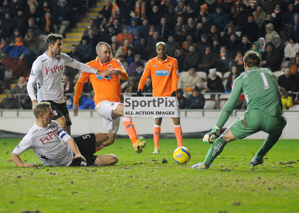 Gary Taylor-Fletcher vies for the ball - Blackpool v Fulham FA Cup Third Round Replay Bloomfield Road 15 January 2013 (c) Greig Bertram | StockPix.eu
