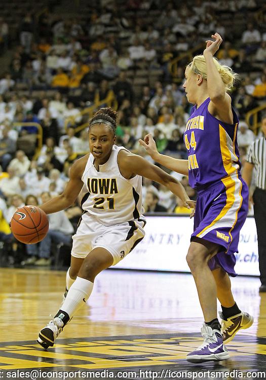 December 22 2010: Iowa guard Kachine Alexander (21) drives around Northern Iowa guard/forward Erin Brocka (44) during the first half of an NCAA college basketball game at Carver-Hawkeye Arena in Iowa City, Iowa on December 22, 2010. Iowa defeated Northern Iowa 75-64.