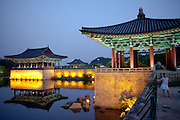 "Girl during an evening at Anapji pond in the city of Gyeongju. Gyeongju was the capital of the ancient kingdom of Silla (57 BC - 935 AD) which ruled most of the Korean Peninsula between the 7th and 9th centuries. A vast number of archaeological sites and cultural properties from this period remain in the city. Gyeongju is often referred to as ""the museum without walls"". / Gyeongju, South Korea, Republic of Korea, KOR, 20th of May 2010."