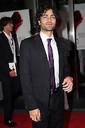 Adrian Grenier posing before entering the 'The Devil Wears Prada' premiere at the AMC LOEWS in Lincoln Square, New York, USA, on Monday, June 20, 2006. He is part of the cast. **ITALY OUT**