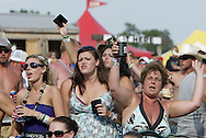 Fans watch and sing along as Brantley Gilbert performs at the 31st annual Country Concert in Fort Loramie, Ohio, Thursday, July 7, 2011.