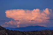 Thunderstorm with miles-long lightning bolt above the Sangre de Cristo Mountains near Taos, NM, viewed from the Jemez Mountains, © 2013 David A. Ponton, [Prints to 8x12, 16x24, 24x36 or 40x60 in. with no cropping]