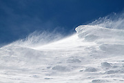 Loose snow blowing in high winds near the summit of active volcano Mount Ruapehu, New Zealand.