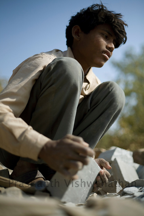 PRASHANTH VISHWANATHAN, INDIA - DECEMBER 18: Raju a 15 year old boy works at a stone quarry in Dabi near Kota, in Rajasthan,  India.(Photo by Prashanth Vishwanathan/Getty Images for the Forbes)