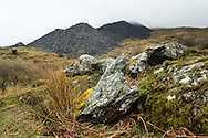Spoil heaps at The Dinorwic Slate Quarry blend in to the landscape at Llanberis in north Wales.