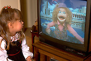 Preschooler age 5 watching Sesame Street television show.  Western Springs  Illinois USA