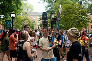AUGUST 26, 2018  ATHENS, OHIO:<br /> Matt Moyseenko, of the Ohio Snowcats (snowboard and skiing organization), holds a snowboard and hands out flyers to new freshman students at his recruitment table on College Green as new freshman students walk through a variety of recruitment tables from other organizations on the OU campus trying to get them to join after the freshman convocation at Ohio University on August 26, 2018 in Athens, Ohio.