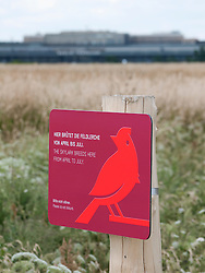 Information sign warning of breeding birds at new city public Tempelhofer Park on site of famous former Tempelhof Airport in Berlin Germany