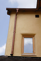 Recyclable copper guttering & down pipe on Eco House at The Wintles; Bishop's Castle; an alternative to environmentally damaging pvc,