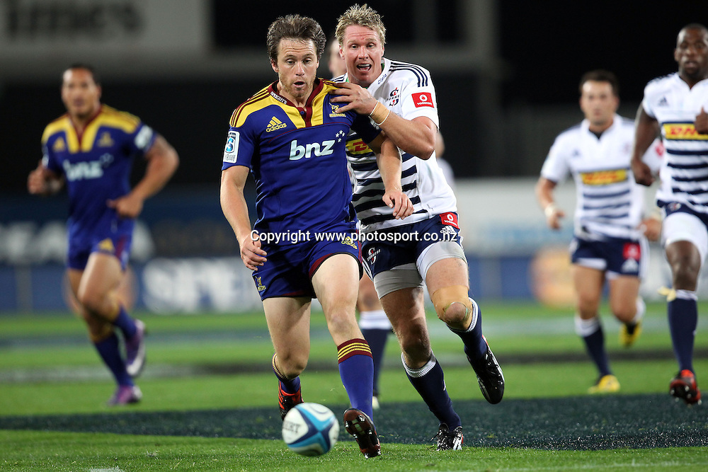 Ben Smith and Jean de Villiers compete for the ball.<br /> Investec Super Rugby - Highlanders v Stormers, 7 April 2012, Forsyth Barr Stadium, Dunedin, New Zealand.<br /> Photo: Rob Jefferies / photosport.co.nz