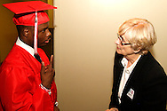 Chris Ross (left) chats with Diane Bohlander of Centerville before the Trotwood-Madison High School commencement at the Victoria Theatre in downtown Dayton, May 29, 2012.