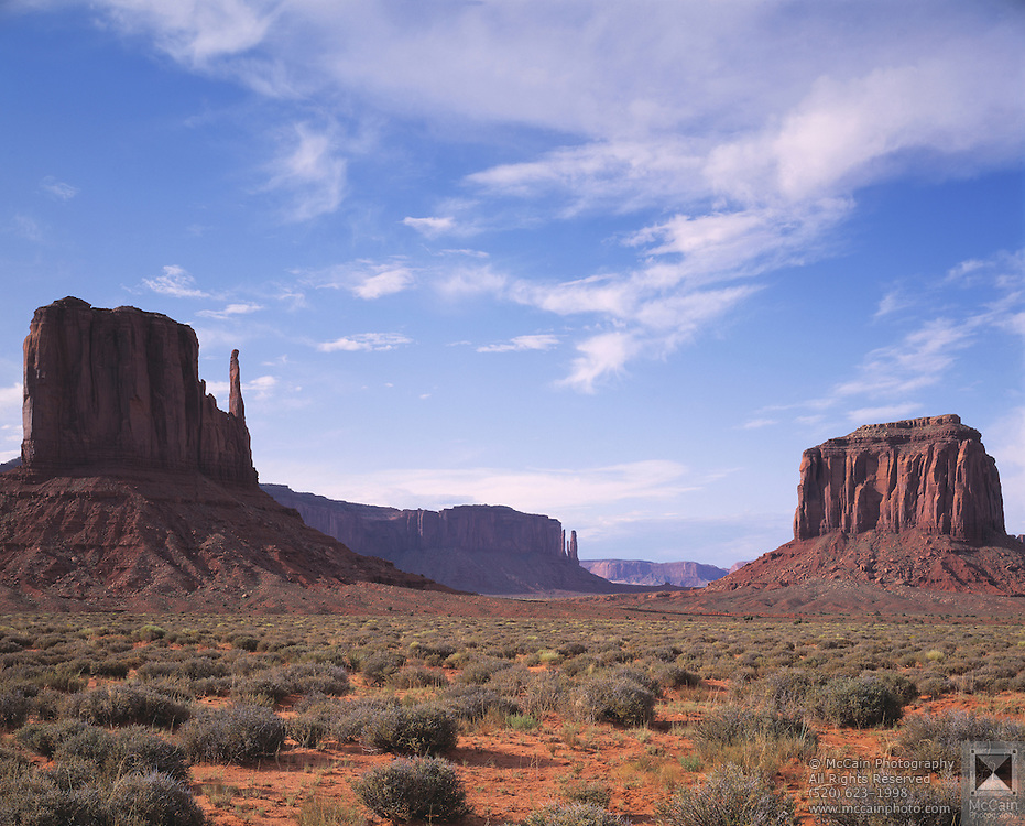 East Mitten Butte, left, West Mitten Butte, right, Mitchell Mesa at center, made  of sandstone from Cutler Formation, Permian Period, Monument Valley, Navajo Tribal Park, near Kayenta, Arizona