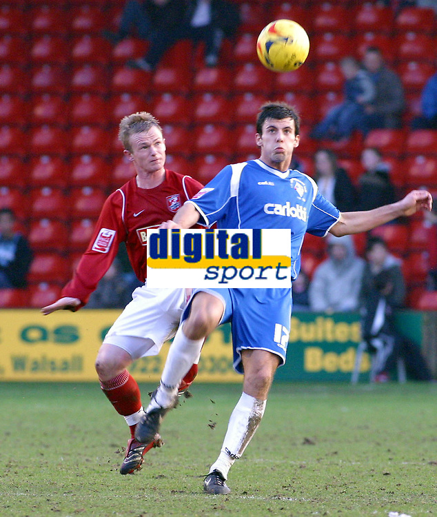 Photo: Dave Linney.<br />Walsall v Oldham Athletic. Coca Cola League 1. 18/02/2006.Walsall's (L) challenges for the ball with  Richard Butcher