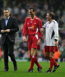 LIVERPOOL, ENGLAND - SUNDAY MARCH 27th 2005: Liverpool Legends' Alan Hansen, Gary Gillespie Kenny Dalglish after the Tsunami Soccer Aid match at Anfield. (Pic by David Rawcliffe/Propaganda)
