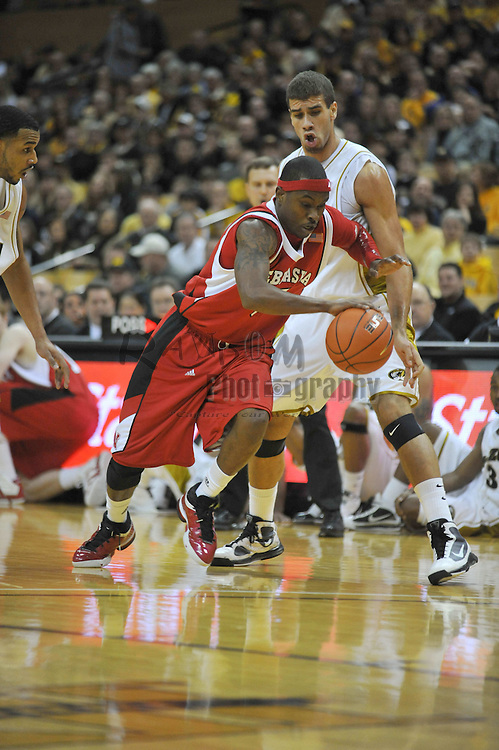 Jan 23, 2010; Columbia, MO, USA; Nebraska Cornhuskers guard Sek Henry (5) drives downcourt as Missouri Tigers forward Justin Safford (23) attempts defense in the first half at Mizzou Arena in Columbia, MO. Missouri won 70-53. Mandatory Credit: Denny Medley-US PRESSWIRE